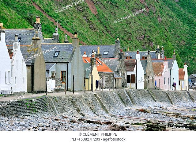 Crovie, a small village on a narrow ledge along the sea comprising a single row of houses in Aberdeenshire, Scotland, UK