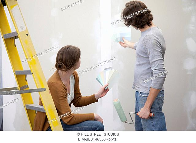 Couple renovating room together