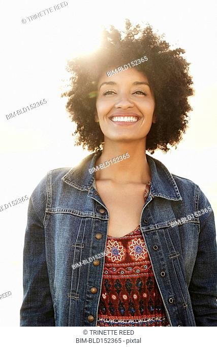 Low angle view of mixed race woman smiling