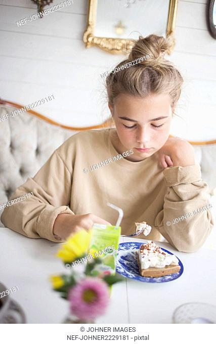 Girl having cake