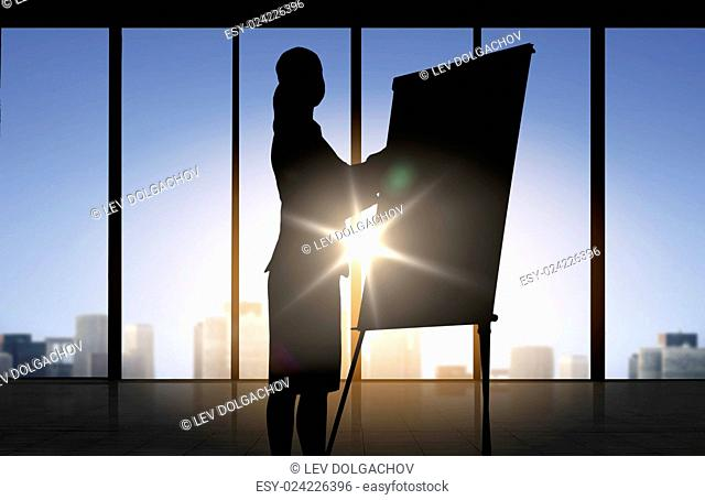 business, strategy, planning and people concept - silhouette of woman with flipboard over office window background