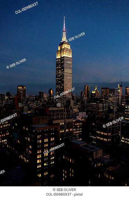 Empire state building illuminated at night, New York, USA