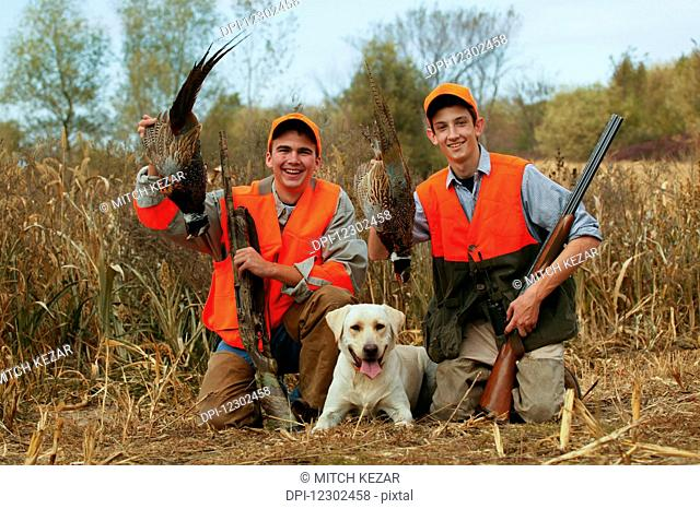 Youth Male Upland Hunters With Pheasant And Yellow Lab