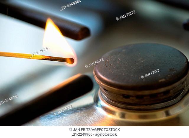 Matchstick lit the gasburner