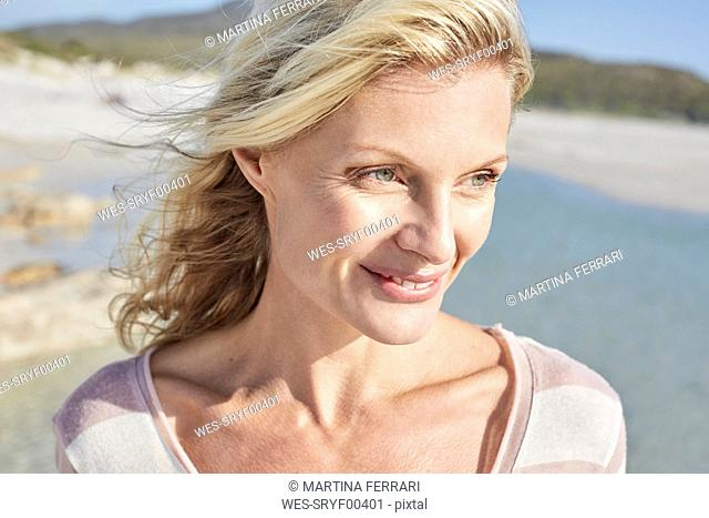 840489ortrait of a mature woman enjoying the sun