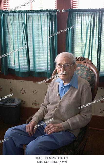Senior man sitting in chair