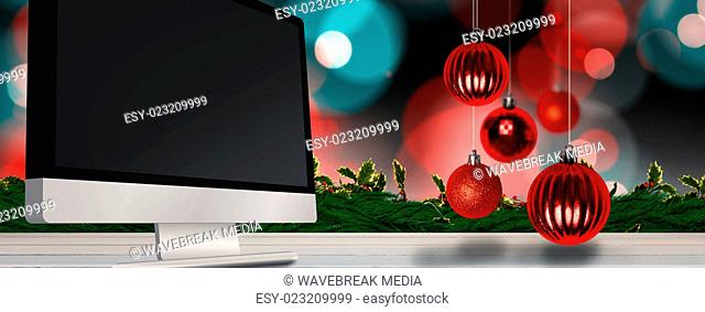Composite image of christmas baubles