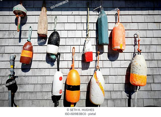 Variety of traditional fishing buoys hanging on wall, Lunenburg, Nova Scotia, Canada