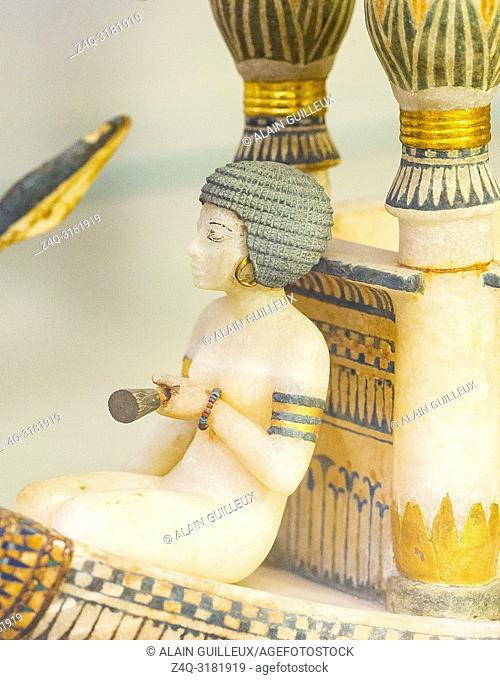 Egypt, Cairo, Egyptian Museum, Tutankhamon alabaster, from his tomb in Luxor : Detail of a boat, woman sitting in front of a kiosk. She holds a lotus