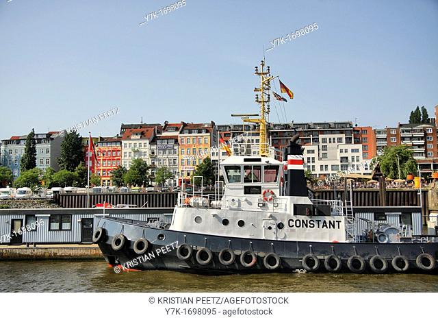 Tugboat infront of the Hafenstrasse and the Strandpauli-Bar in Hamburg, Germany