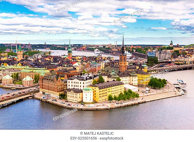Panoramic view of swedish capital Stockholm seen from the city hall tower. Aerial view of Gamla stan, old medieval downtown. Horizontal composition