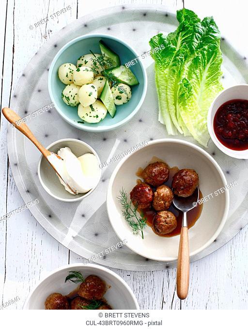 Platter with Swedish meatballs and salad