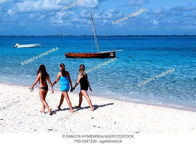 three young woman walking at the seaside, Africa, Mascarene, Mascarene Islands, Mascarenhas, Mauritius, Southeastern coast of Mauritius, Grand Port District