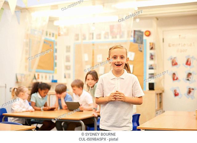 Portrait of schoolgirl in classroom lesson at primary school