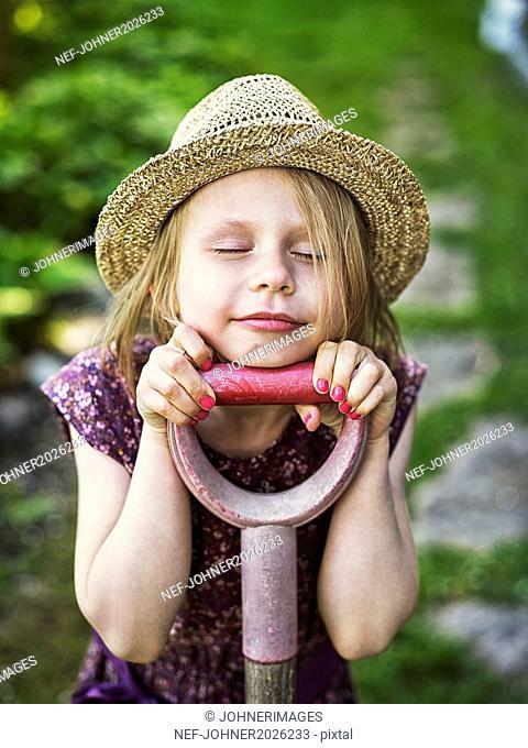 Smiling girl wearing straw hat