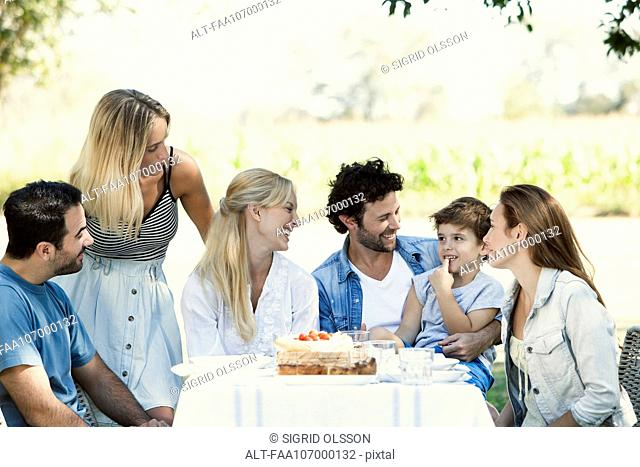 Family and friends spending time together outdoors