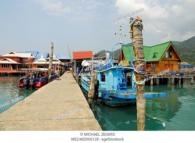 Thailand, Pier with boats and buildings on Bang Bao bay at Mu Ko Chang National Park