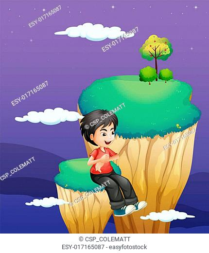 A boy waiting for someone at the topmost part of a landform