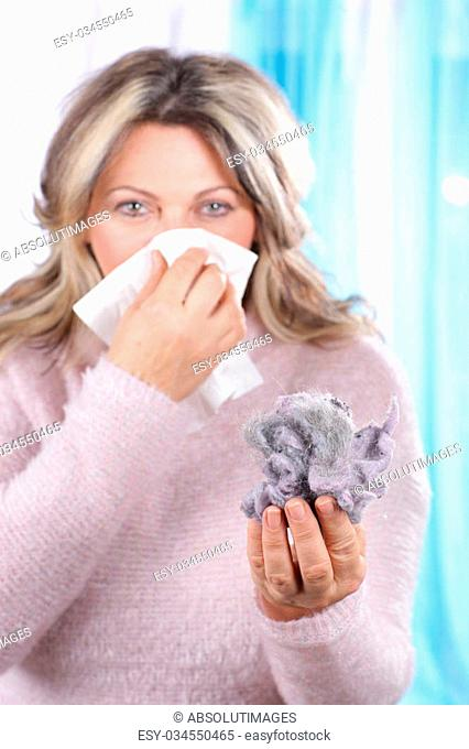 Matured woman with housedust and handkerchief having allergy