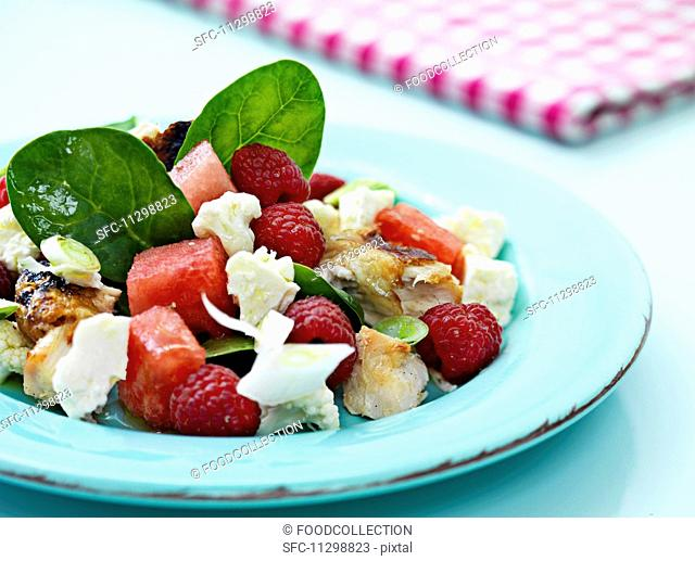 Chicken salad with watermelon and raspberries