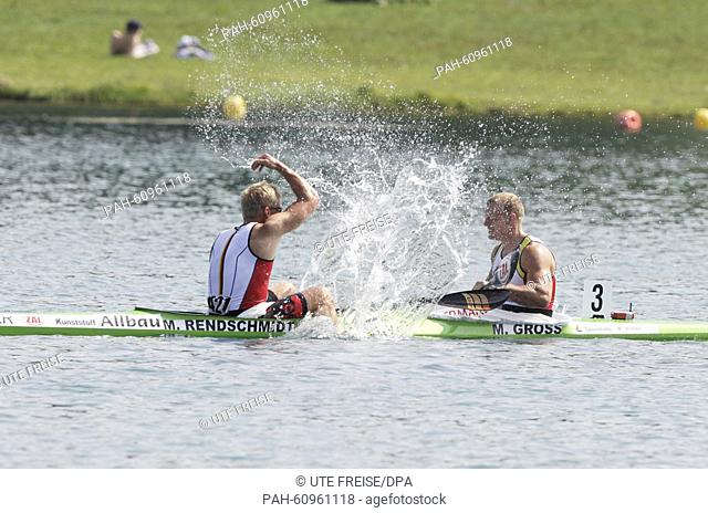 Max Rendschmidt (L) and Marcus Gross of Germany celebrate after winning gold in the men's kayak double 1000 m event during the ICF Canoe Sprint World...