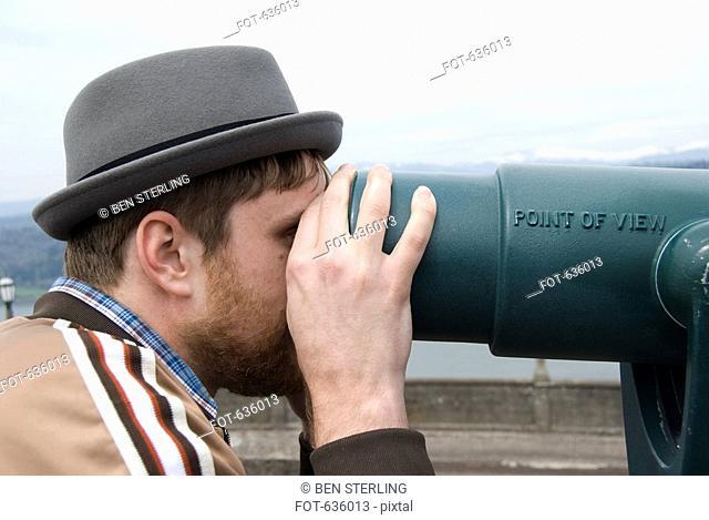 A man looking through a viewfinder, Oregon
