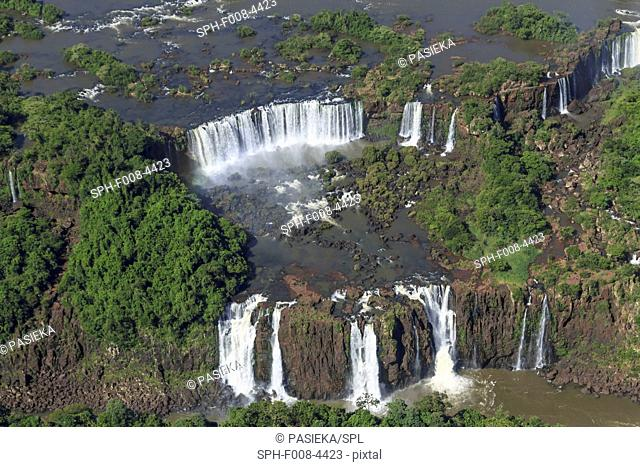 Aerial view of the Iguazu falls, Argentina. Iguazu Falls, named after the Guarani word for 'great water', are four times the width of Niagara Falls and are...