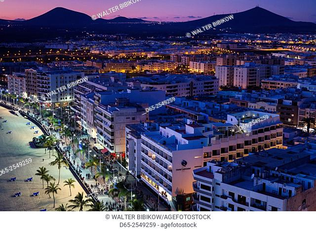 Spain, Canary Islands, Lanzarote, Arecife, elevated city view above Playa del Reducto beach, dusk