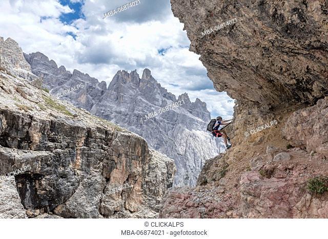 Climber on the via ferrata Cengia Gabriella, Popera group, Giralba, Sexten Dolomites, Belluno, Veneto, Italy