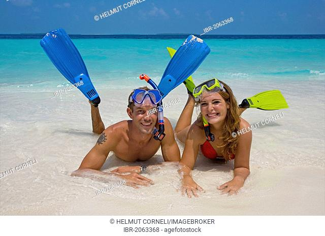 Couple, snorkelers on the beach of Reethi Beach Island, Baa Atoll, Maldives, Indian Ocean, Asia