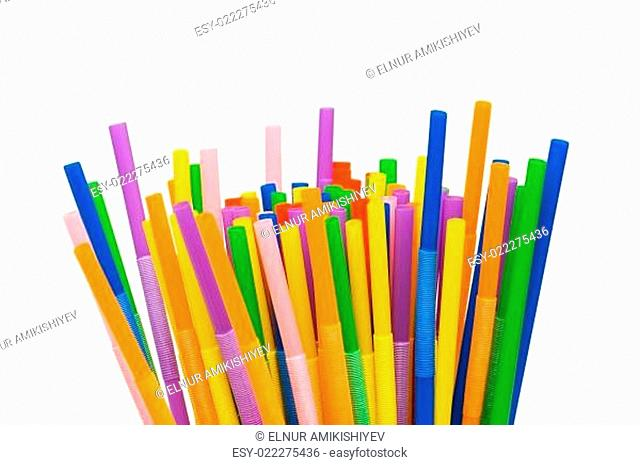 Lots of drinking straws isolated on white