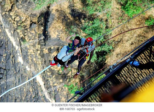 Young man bungee jumping Stock Photos and Images | age fotostock