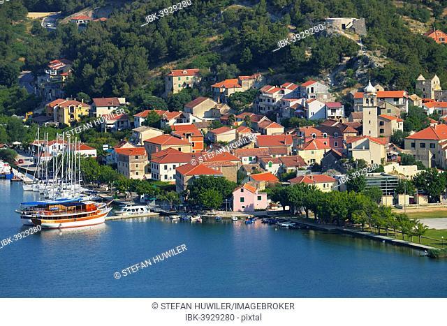 Townscape with sailing ship in the foreground, River Krka, Skradin, Dalmatia, Croatia