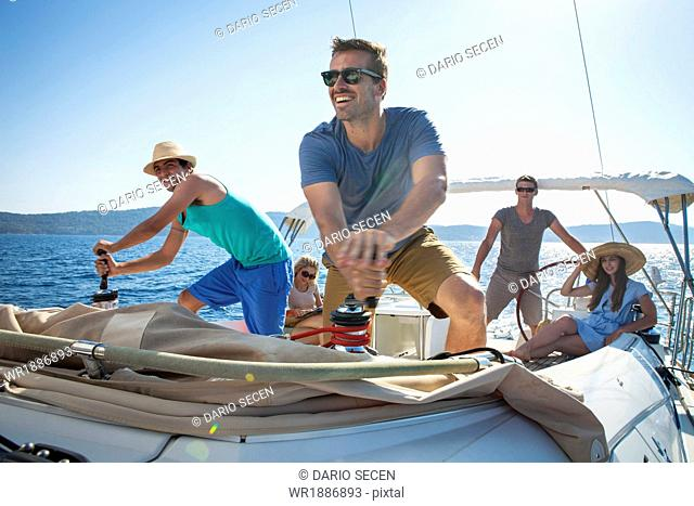 Croatia, Adriatic Sea, Young people on sailboat