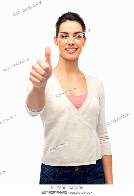 gesture, fashion, portrait and people concept - happy smiling young woman with braces showing thumbs up over white