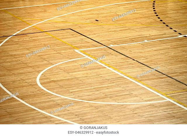 Lines of wooden floor basketball court in the sports hall