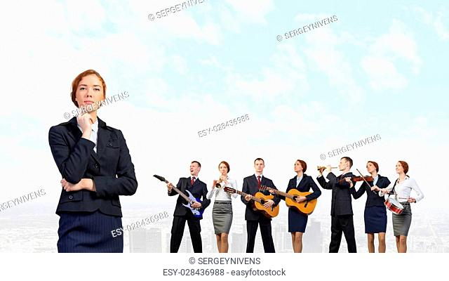 Young woman in suit playing different music instruments