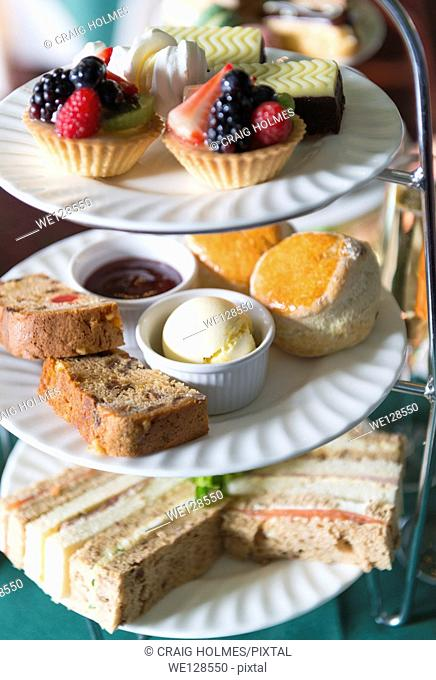 An afternoon tea cake and sandwich stand