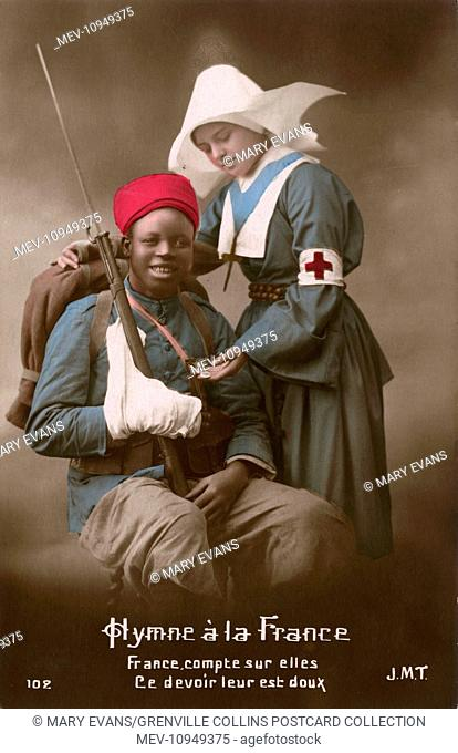 WW1 - An injured colonial French Soldier (Senegalese?) cared for by a pretty nurse