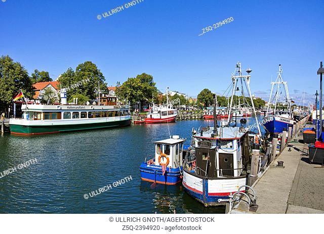 Fishing cutters by the Alter Strom canal in Rostock-Warnemunde, Germany