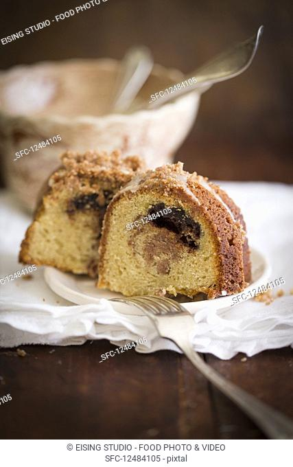 Two slices of sour cream coffee cake on a plate