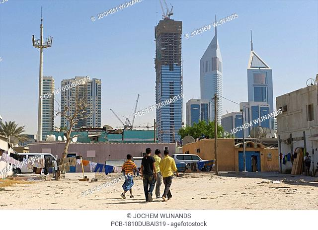 Dubai, small houses of migrants near the the emirate twin towers and sheik zayed road area