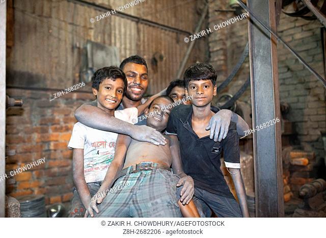 DHAKA, BANGLADESH - JUNE 11 : Children working riskey environment inside Aluminium pot factory in Dhaka, Bangladesh on June 11, 2016