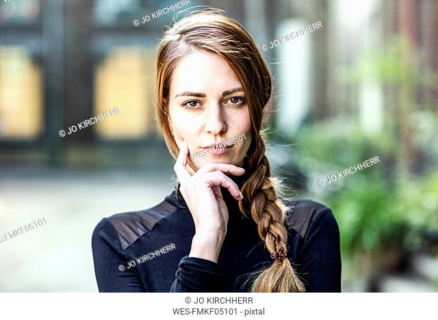 Portrait of serious woman with braid
