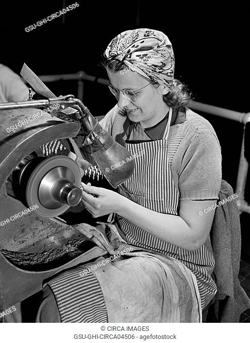 Female Worker Polishing Screws for Valve Rocker Arms of Airplane Engines on Gardner Machine at Manufacturing Plant, Pratt & Whitney, East Hartford, Connecticut