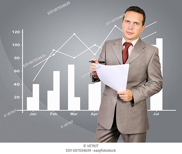 businessman with paper and chart on background