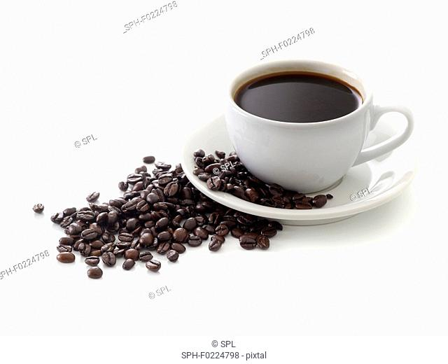 Black coffee in cup with beans