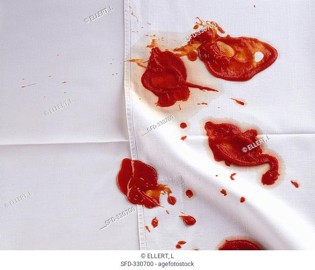 Blobs of ketchup on tablecloth