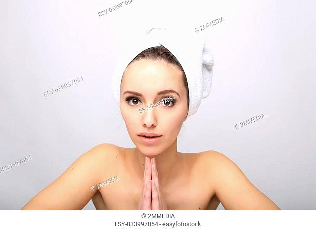 Beautiful Happy Spa Girl Isolated on a White Background.Touching her Face. Happy Woman after Bath with Clean Perfect Skin