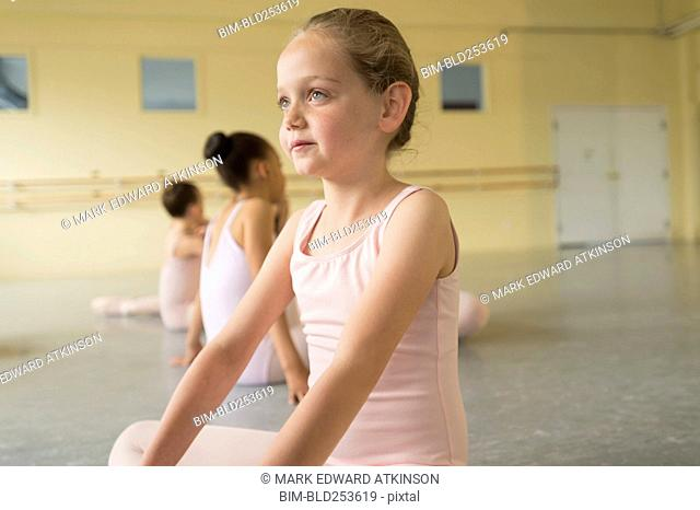 Girl sitting on floor of ballet studio